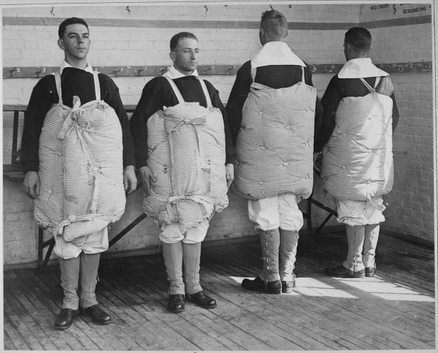 Naval-recruits-demonstrating-mattresses-as-life-preservers-620x500