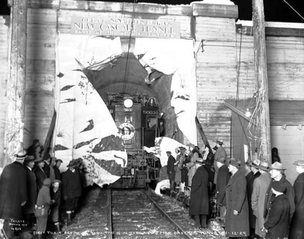 First-train-breaking-through-the-Cascade-Tunnel-Washington