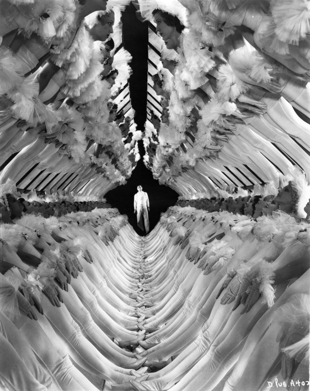 Portrait of Busby Berkeley, highly influential Hollywood movie director and musical choreographer, at the end of a 'tunnel' of girls for his Warner Musical Picture, 'Dames,' New York, New York, early to mid 20th century. (Photo by Visual Studies Workshop/Getty Images)