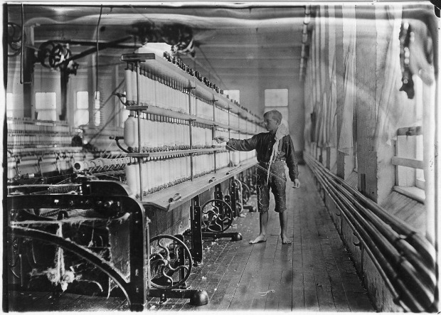 mule-spinning_room_in_chace_cotton_mill-_raoul_julien_a_-back-roping_boy-_has_been_here_2_years-_burlington_vt-_-_nara_-_523189