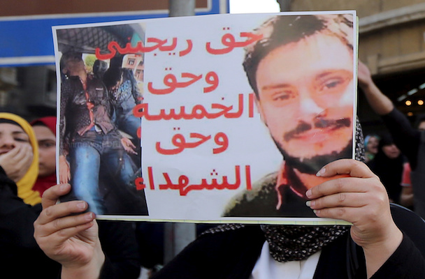 An Egyptian activist holds a poster during a demonstration in front of the Press Syndicate in Cairo